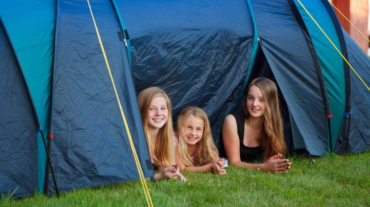 Girls looking outside the tent