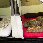 Inside of a big family tent - Two cabins with inflatable mattresses for comfort at camping
